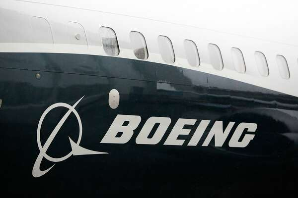 (FILES) In this file photo taken on March 7, 2017 shows the Boeing logo on the Boeing 737 MAX 9 airplane at the Boeing factory in Renton, Washington. US President Donald Trump's decision to withdraw from the Iran nuclear pact threatens new business for several big companies, including Boeing, Airbus and General Electric. The two aerospace giants were among the companies to receive US Treasury licenses to begin conducting business in Iran under strict oversight after sanctions were lifted in the 2015 accord.Even amid this easing, Washington continued to keep in place an embargo on American citizens operating in Iran and barred Iranian entities from using the US financial system.  / AFP PHOTO / Jason RedmondJASON REDMOND/AFP/Getty Images