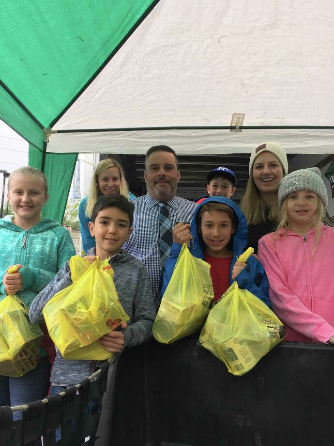 Volunteers from Riverside School accept donations at last year's Stamp Out Hunger event. Photo: Contributed