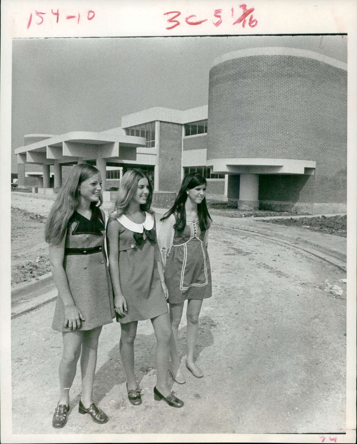 PHOTOS: The early days of SharpstownAug. 16, 1970: New Sharpstown High viewed by transfer students Dee Ann Patrlak, Lynn Portis and Nancy Hastings.