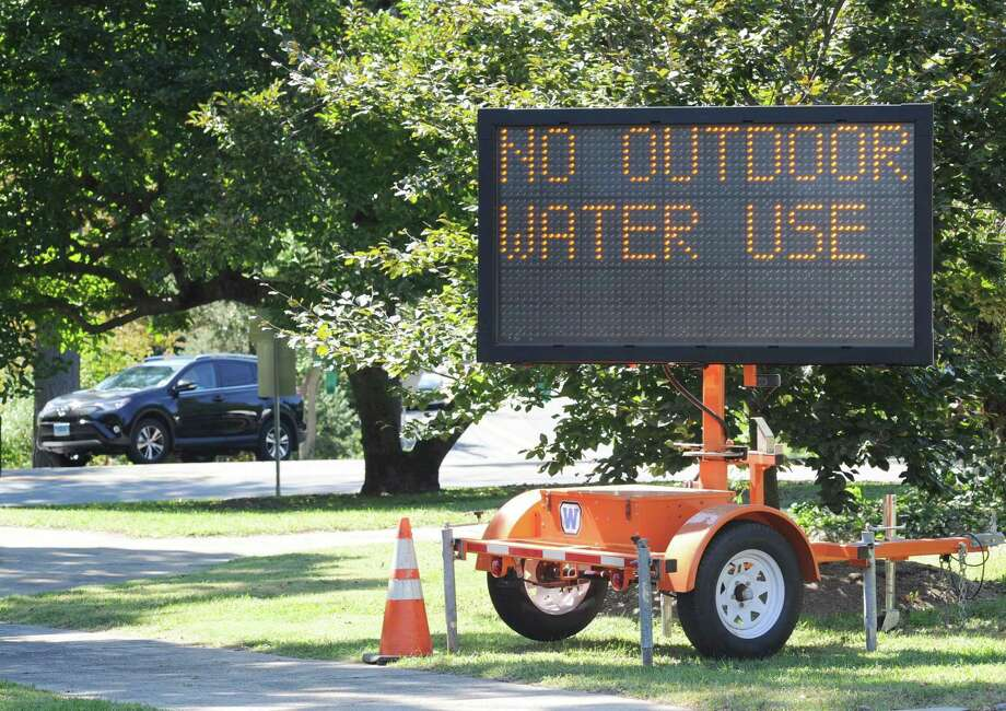 A sign alerts Greenwich, Conn. drivers of water limitations during drought conditions in September 2016. While Greenwich and other southwestern Connecticut towns have kept watering restrictions in place, the drought spurred relatively few commercial property owners to invest in water conservation measures beyond existing plans, whether in the form of new technologies or landscaping. Photo: Bob Luckey Jr. / Hearst Connecticut Media / Greenwich Time