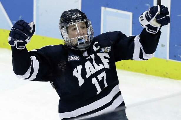 Yale's Andrew Miller (17) celebrates his break away goal in the third period of the NCAA men's college hockey national championship game in Pittsburgh Saturday, April 13, 2013. Yale beat Quinnipiac 4-0. (AP Photo/Gene J. Puskar)