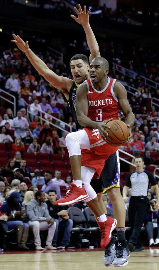 FILE - In this Jan. 20, 2018, file photo, Houston Rockets guard Chris Paul (3) shoots in front of Golden State Warriors guard Klay Thompson (11) during the second half of an NBA basketball game, in Houston. The buildup to this Golden State-Houston matchup in the Western Conference finals started in February, when Draymond Green had some pointed comments. Or in October, when the Rockets beat the Warriors on ring night. Or in June, when Chris Paul got traded. Whatever the case, the series that everyone in the NBA apparently wanted to see is about to happen. (AP Photo/Michael Wyke, File) Photo: Michael Wyke, FRE / © Associated Press 2018