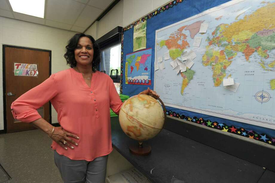 Social studies teacher Camille Spaulding poses for a photo inside her Cloonan Middle School classroom in Stamford, Conn. on Tuesday, May 8, 2018. Spaulding was named Stamford's 2018 teacher of the year. Photo: Michael Cummo / Hearst Connecticut Media / Stamford Advocate
