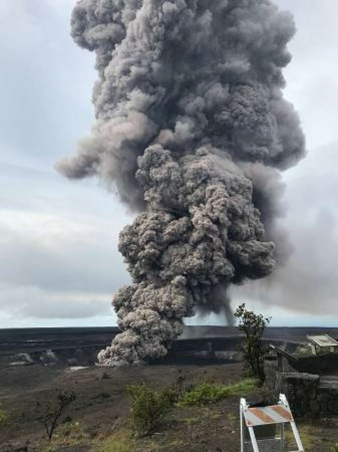 "May 9, 2018: From the USGS: ""Ash column rises from the Overlook crater at the summit of Kīlauea Volcano. HVO's interpretation is that the explosion was triggered by a rockfall from the steep walls of Overlook crater. The photograph was taken at 8:29 a.m. HST from the Jaggar Museum overlook. The explosion was short-lived. Geologists examining the ash deposits on the rim of Halema'uma'u crater found fresh lava fragments hurled from the lava lake. This explosion was not caused by the interaction of the lava lake with the water table. When the ash cleared from the crater about an hour after the explosion, geologists were able to observe the lava lake surface, which is still above the water table."" Photo: U.S. Geological Survey"