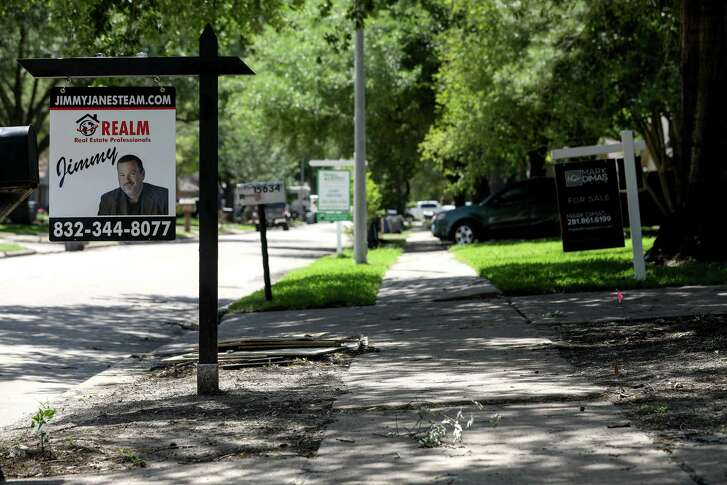 """Signs reading """"For Rent"""" and """"For Sale"""" line the streets in the Bear Creek neighborhood, Tuesday, April 17, 2018, in Houston."""