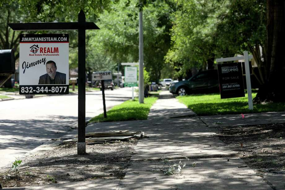"Signs reading ""For Rent"" and ""For Sale"" line the streets in the Bear Creek neighborhood, Tuesday, April 17, 2018, in Houston. Photo: Jon Shapley / © 2018 Houston Chronicle"