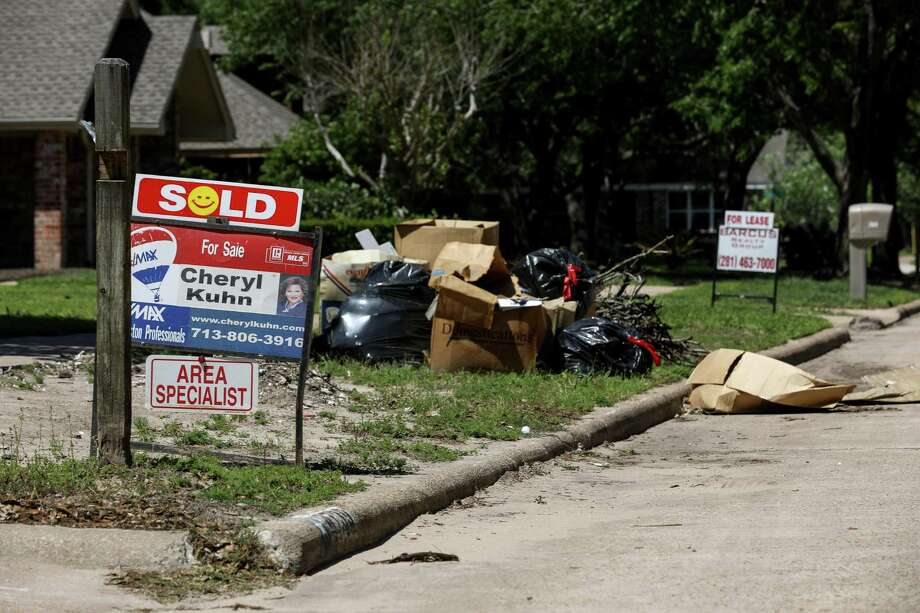 "Signs reading ""For Rent"" and ""For Sale"" line the streets in the Bear Creek neighborhood, Tuesday, April 17, 2018, in Houston.  ( Jon Shapley / Houston Chronicle ) Photo: Jon Shapley, Houston Chronicle / © 2018 Houston Chronicle"