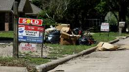 """Signs reading """"For Rent"""" and """"For Sale"""" line the streets in the Bear Creek neighborhood, Tuesday, April 17, 2018, in Houston.  ( Jon Shapley / Houston Chronicle )"""