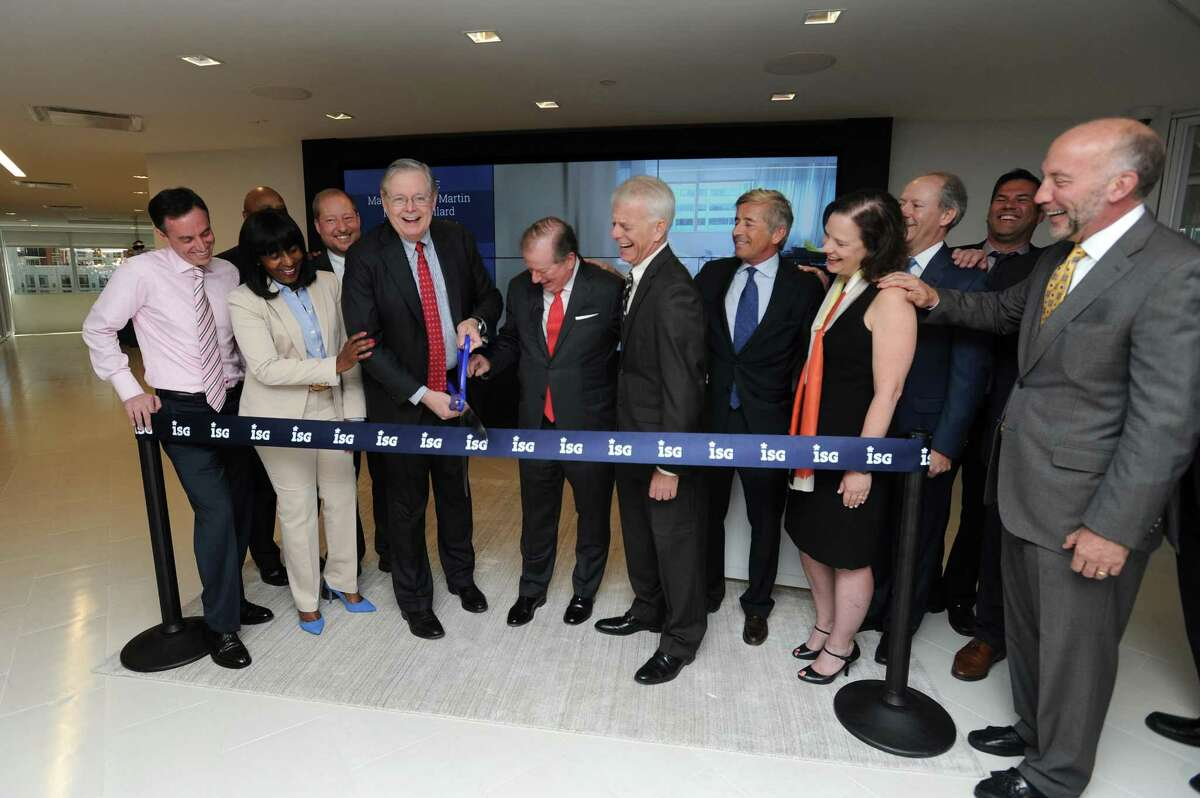 Stamford mayor David Martin (center left) and ISG CEO Michael Connors cut the ceremonial ribbon at the IT consulting and research firm's new offices at 2187 Atlantic St., in the Harbor Point area of Stamford, Conn., on Wednesday, May 9, 2018.