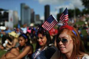 Claudia Knoll, right, 19, Megan Gusman, center, 19, and Hailee Higgins, 19, enjoy the performance of The Suffers at the  Freedom Over Texas festival, Monday, July 4, 2016, in Houston. ( Marie D. De Jesus / Houston Chronicle )