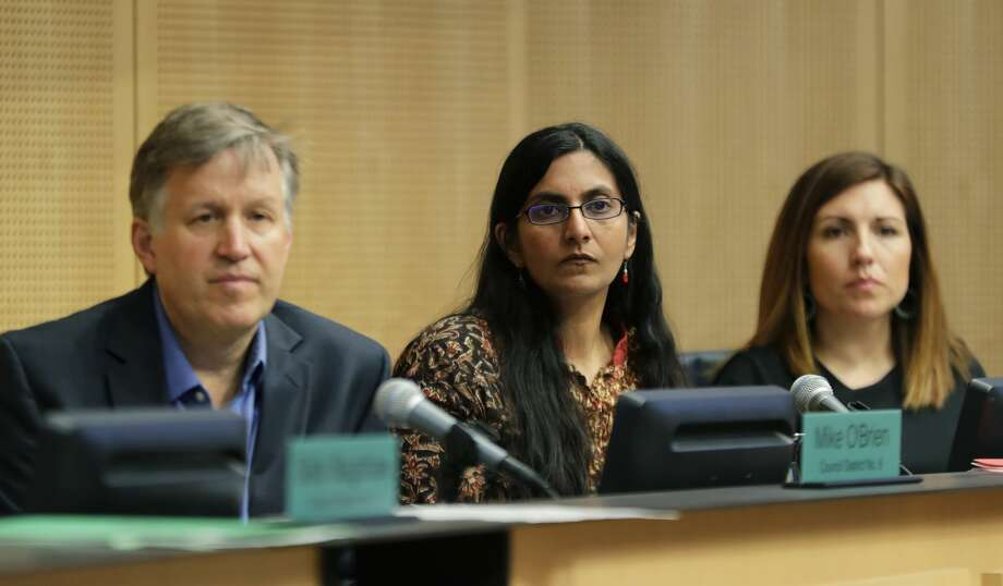"Seattle City Council members Mike ""Nanny State"" O'Brien, Kshama Sawant, and Teresa Mosqueda, right, listen to public comments on a controversial proposal to tax large businesses such as Amazon.com to fund efforts to combat homelessness, Wednesday, May 9, 2018. Sawant is up for reelection this year, and in a tough race.  O'Brien is bailing and not seeking reelection. Mosqueda goes before voters in 2021. Photo: Ted S. Warren/AP"