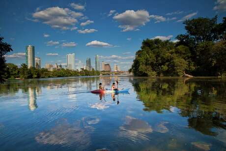 Kayakers take in the Austin skyline from Lady Bird Lake, which is encircled by a hiking-and-biking trail that stretches more than 10 miles.
