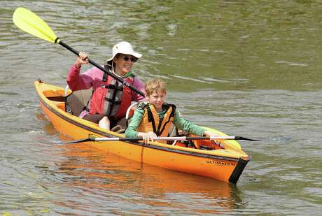 Lisa Berezny, of The Woodlands, and her son, Rhys, paddle the kayak they rented from the Riva Row Boat House, located along The Woodlands Waterway. Riva Row had extended hours during the Conreo ISD Spring Break week for residents to enjoy their rental kayaks. Photo by David Hopper