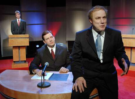 From left: Troy Schulze as John Kerry, Seé¥n Patrick Judge as Jim Lehrer and Paul Locklear as George Bush during rehearsals for the Catastrophic Theatre's production of The Strangerer at Diverse Works Monday Oct. 13,2008. (Dave Rossman/For the Chronicle)