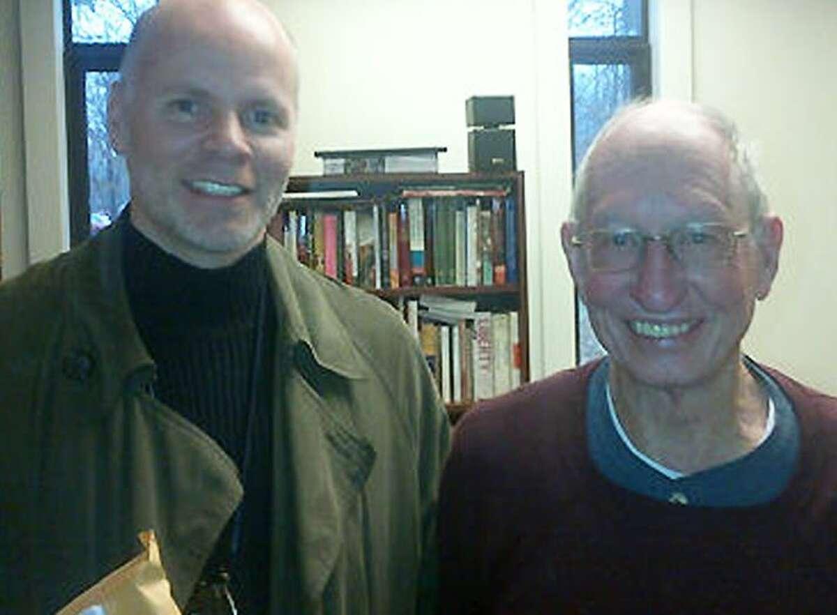 Former student Michael Huber (left) and Professor Warren Roberts shortly before his retirement.