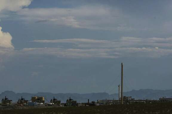 An Apache Corp. gas processing plant sits in front of the Davis Mountains Monday, July 17, 2017 in Balmorhea in West Texas. First-quarter earnings reported showed that shale drillers are spending conservatively and controlling costs, which is bolstering their bottom lines.
