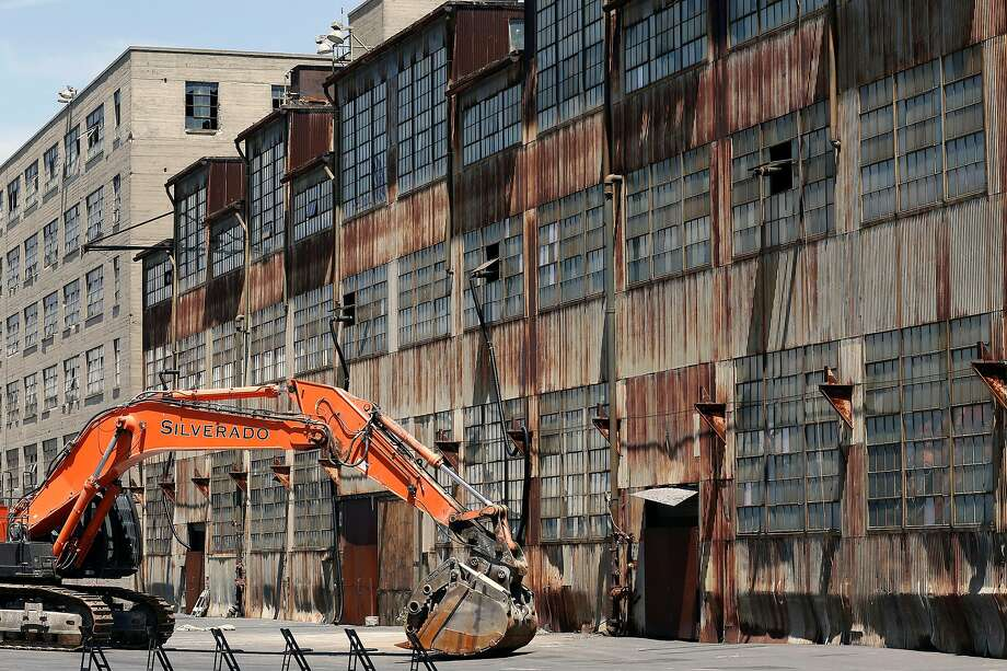 Buildings 2, (left) and 12 on Pier 70 in San Francisco, Ca. on Wed. May 9, 2018, where construction is set to begin for the massive redevelopment that will turn 35 acres of dilapidated shipyard into housing, commercial space, waterfront parks and artist studios. Photo: Michael Macor, The Chronicle
