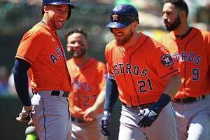 Houston Astros' Derek Fisher (21) celebrates with George Springer, left, after hitting a home run off Oakland Athletics' Daniel Mengden in the seventh inning of a baseball game Wednesday, May 9, 2018, in Oakland, Calif. (AP Photo/Ben Margot)