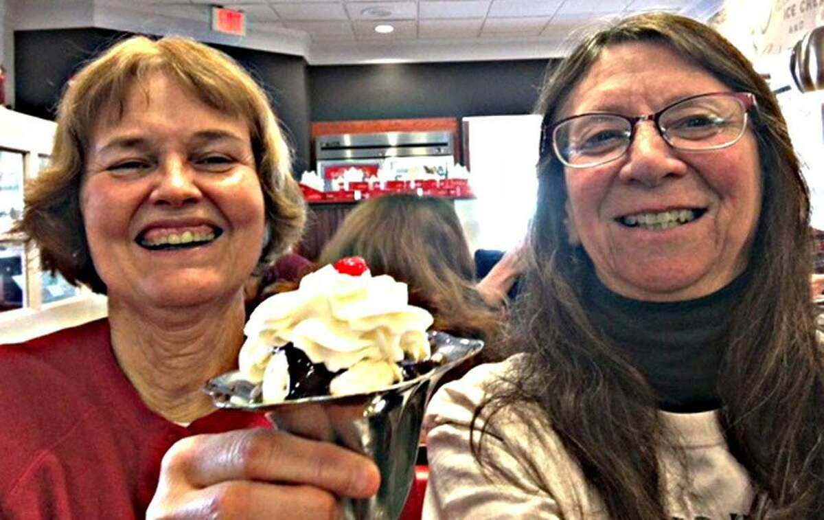 Lapin, left, and Czuba enjoy a sweet ending to their hiking jaunt at Friendly's.