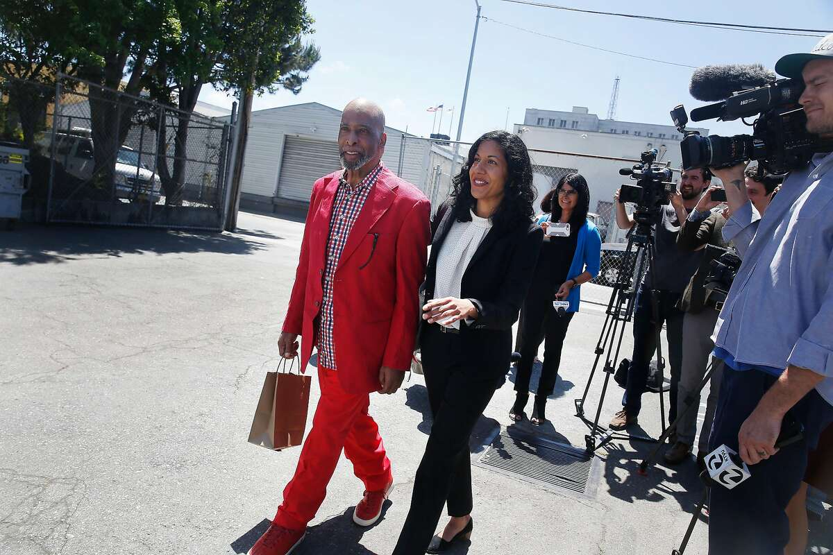 Kenneth Humphrey (l to r) and Anita Nabha, Deputy Public Defender walk back to a transport van after talking with the media at the San Francisco Sheriff's Department on Wedesday, May 9, 2018 in San Francisco, Calif. Months after a state appeals court found that his $350,000 bail was unconstitutionally excessive because he couldn't come close to affording it, Humphrey is released from jail.