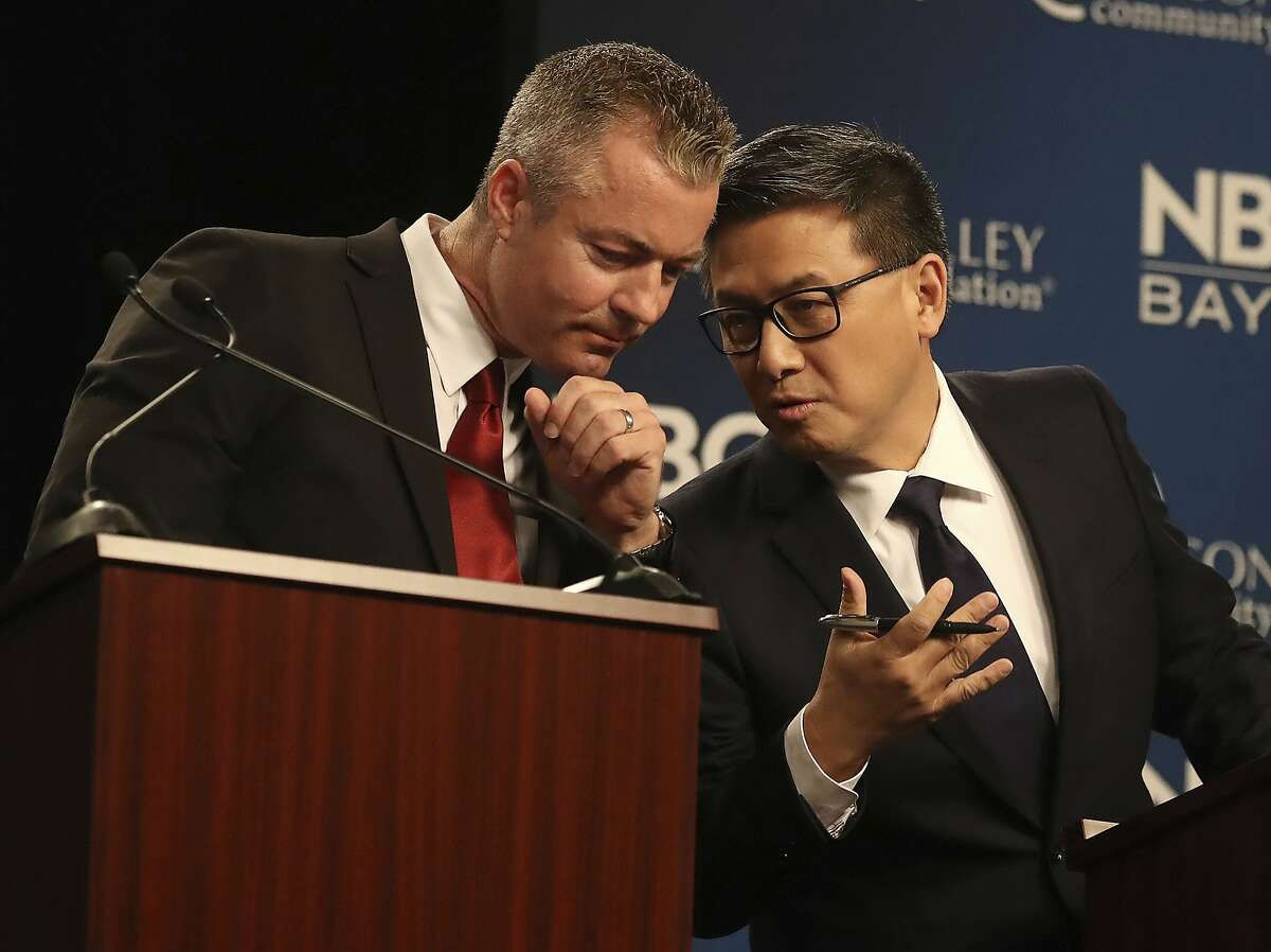Republican gubernatorial candidate Travis Allen, left, talks with Democratic candidate John Chiang during a debate at the California Theatre, Tuesday, May 8, 2018, in San Jose, Calif. (Aric Crabb/San Jose Mercury News-Bay Area News Group via AP)