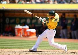 OAKLAND, CA - MAY 09:  Dustin Fowler #11 of the Oakland Athletics lines out to second base in his first major league at bat in the seventh inning of their game against the Houston Astros at Oakland Alameda Coliseum on May 9, 2018 in Oakland, California.  (Photo by Ezra Shaw/Getty Images)