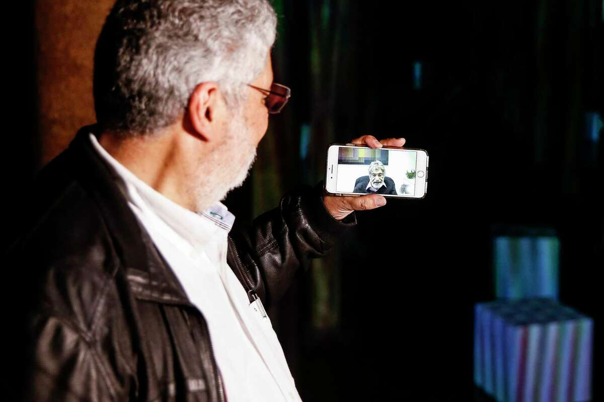 """Carlos Cruz-Diez Jr. left, takes his father, artist Carlos Cruz-Diez, on a video call tour of his site specific """"Spacial Chromointerference"""" work at the Buffalo Bayou Park Cistern Wednesday, May 9, 2018 in Houston. (Michael Ciaglo / Houston Chronicle)"""