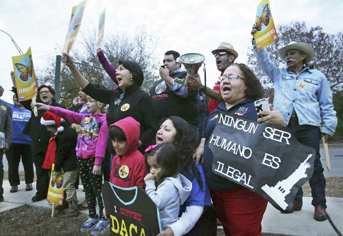 Demonstrators shout out their demand for a clean Dream Act as the president of the Texas State Teachers Association and San Antonio educators rally outside Congressman Will Hurd's office in San Antonio on December 14, 2017.