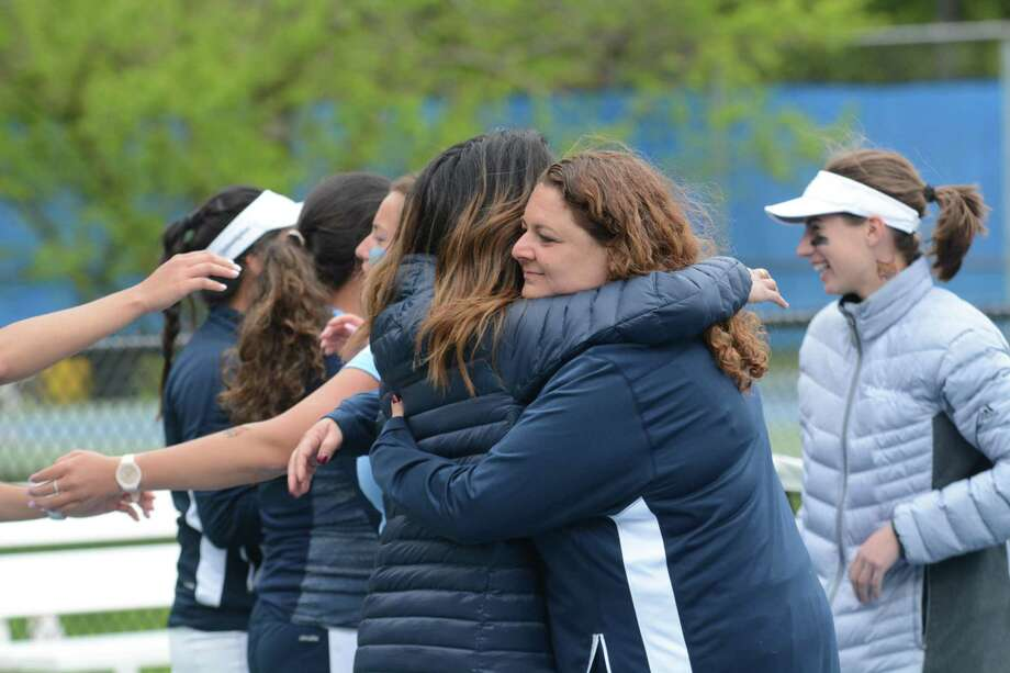 Quinipiac women's coach Paula Miller, left, celebrates the Bobcats MAAC title recently with assistant coach Christine Abundo. Photo: Quinnipiac Athletics