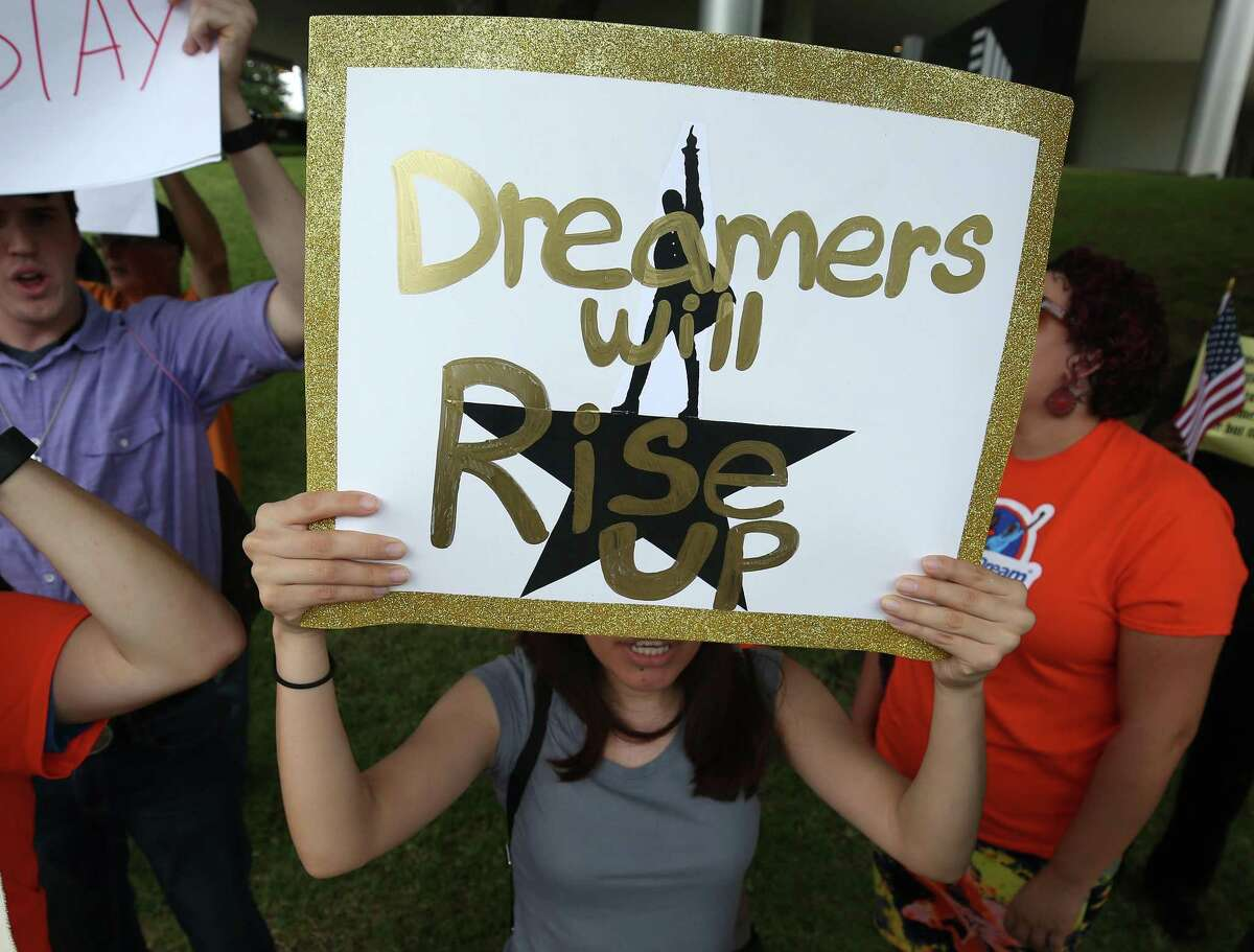 """People with United We Dream Houston rally in 2017 outside Sen. John Cornyn's office to voice their support for a """"Dream Act"""" without dangerous enforcement add-ons."""