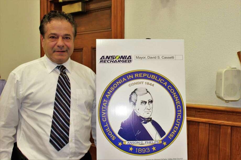 Ansonia Mayor David Cassetti and new Ansonia city seal. Photo: Jean Falbo / For Hearst Connecticut Media