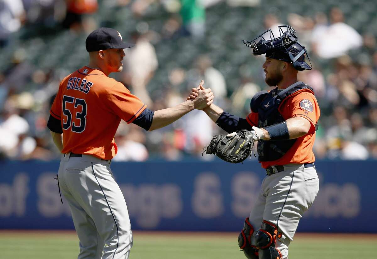 OAKLAND, CA - MAY 09: Ken Giles #53 of the Houston Astros shakes hands with Max Stassi #12 after they beat the Oakland Athletics at Oakland Alameda Coliseum on May 9, 2018 in Oakland, California. (Photo by Ezra Shaw/Getty Images)
