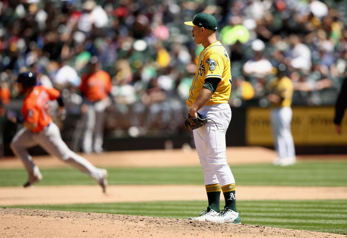 OAKLAND, CA - MAY 09: Max Stassi #12 of the Houston Astros rounds the bases after he hit a home run off of Daniel Mengden #33 of the Oakland Athletics in the seventh inning at Oakland Alameda Coliseum on May 9, 2018 in Oakland, California. (Photo by Ezra Shaw/Getty Images)