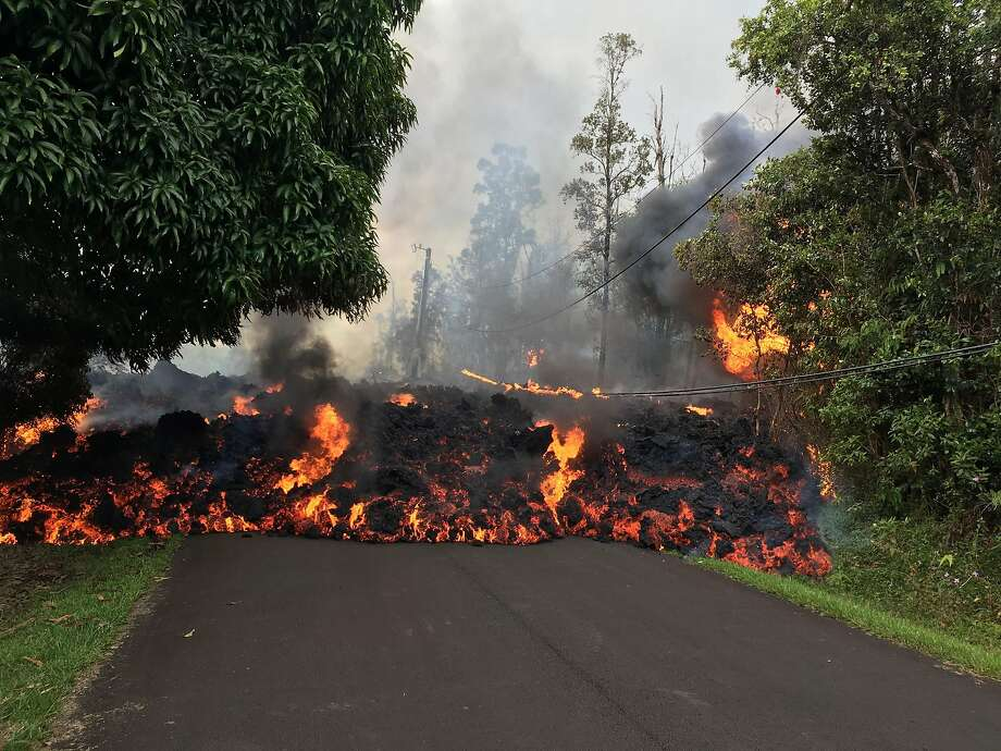 "This image obtained May 9, 2018, released by the US Geological Survey shows a lava flow moving on Makamae Street in Leilani Estates at 09:32 am local time, on May 6, 2018 in Leilani Estates, Hawaii. The Kilauea Volcano, the most active in Hawaii, was highly unstable on May 6, 2018, as lava spouted into the air and fissures emitted deadly gases -- hazards that have forced thousands of people to evacuate. / AFP PHOTO / US Geological Survey / HO / RESTRICTED TO EDITORIAL USE - MANDATORY CREDIT ""AFP PHOTO / US Geological Survey/HO"" - NO MARKETING NO ADVERTISING CAMPAIGNS - DISTRIBUTED AS A SERVICE TO CLIENTS  HO/AFP/Getty Images Photo: HO, AFP/Getty Images"