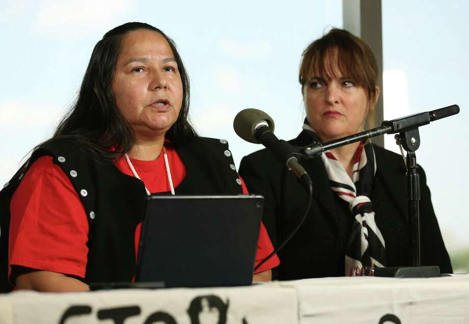 Neskonlith te Secwepemc chief Judy Wilson, left, talks with reporters during a press conference at the Houston Public Library following an appearance Kinder Morgan International's  Annual General Meeting Wednesday, May 9, 2018, in Houston. Wilson talked about the opposition  to the Trans Mountain Pipeline. ( Godofredo A. Vasquez / Houston Chronicle ) Photo: Godofredo A. Vasquez, Houston Chronicle / Houston Chronicle / Godofredo A. Vasquez