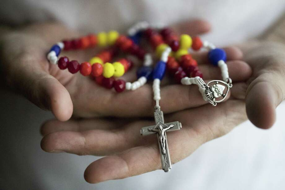 Maria Esther Aguilera has been making Astros rosaries since the 2017 baseball season. The rosaries became hot commodities during the Astros' run to the World Series and ended with crowds waiting in line for the rosary beads during the World Series. The designs vary and some of them are designed resembling the retro colors of the team. Monday, May 7, 2018, in Houston. ( Marie D. De Jesus / Houston Chronicle ) Photo: Marie D. De Jesus, Houston Chronicle / Houston Chronicle / © 2018 Houston Chronicle