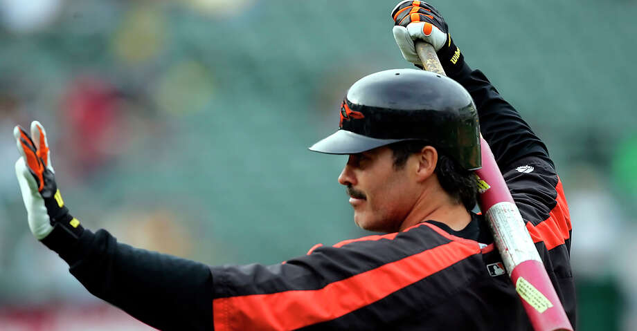 FILE - In this Aug. 15, 2005, file photo, Baltimore Orioles' Rafael Palmeiro waves to fans as he prepares to take batting practice for the team's baseball game against the Oakland Athletics in Oakland, Calif. Palmeiro says he has agreed to play with his son for the independent Cleburne (Texas) Railroaders at age 53. Palmeiro told the Dallas Morning News in a text Tuesday that he is looking forward to joining the second-year American Association team and will be teammates with his 28-year-old son Patrick. Nobody gave me a chance to go to spring training, so I will just take this path, Palmeiro said in the text. (AP Photo/Marcio Jose Sanchez, File) Photo: Marcio Jose Sanchez/Associated Press