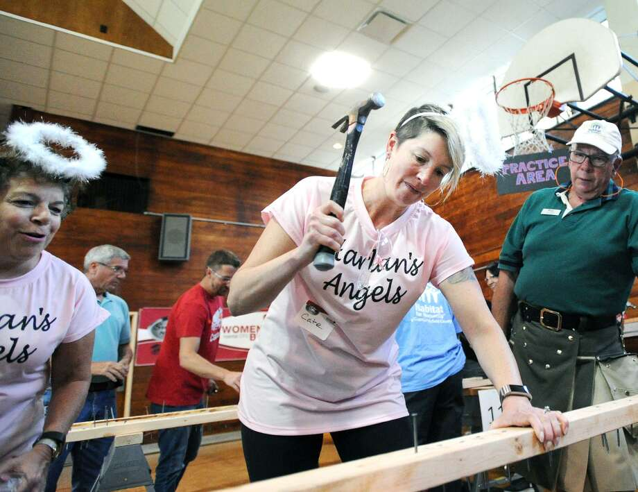 """Harlan's Angels"" team-member Cate French of the Halstead New England Compnay, hammers away during the Habitat for Humanity of Costal Fairfield County's Women Build 3rd annual ""She Nailed It!""  ladies-only nail hammering relay competition at the Old Greenwich Civic Center, Conn., Wednesday night, May 9, 2018. Funds raised from the event went to support the building of the 15th Women Build home in Fairfield County. Photo: Bob Luckey Jr. / Hearst Connecticut Media / Greenwich Time"