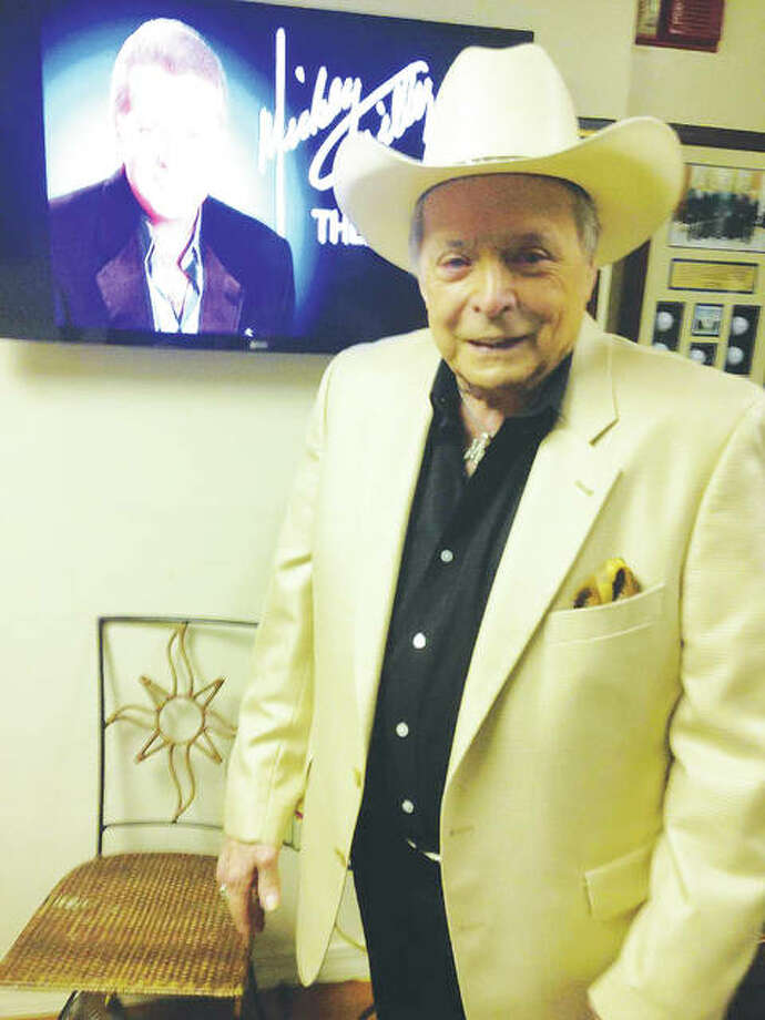 "Ron Young Nashville Productions brought Mickey Gilley to Godfrey's Lewis and Clark Community College, where Gilley is pictured, four years ago as a benefit for 5As no-kill animal shelter in Alton. This time, he is performing ""An Evening With Mickey Gilley"" to benefit the Grafton Police Department, to which 100 percent of the proceeds will be donated. Photo:       For The Telegraph"