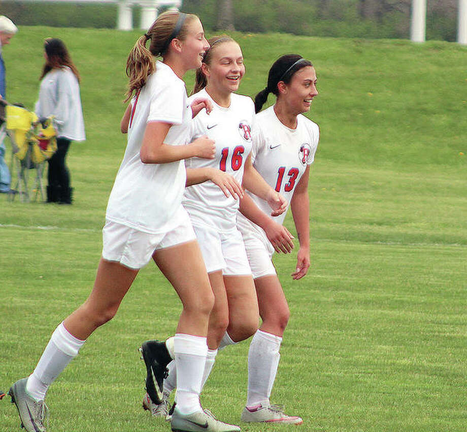 Roxana's Macie Lucas, left, Emma Lucas, center, and Brynn Huddleston celebrate after a goal by Emma Lucas. The Shells got two from Emma Lucas, two from younger sister Macie Lucas and from Huddleston in Wednesday's 5-0 victory over Breese Central in the semifinals of the Class 1A Central regional in Breese. Photo:     Pete Hayes | The Telegraph