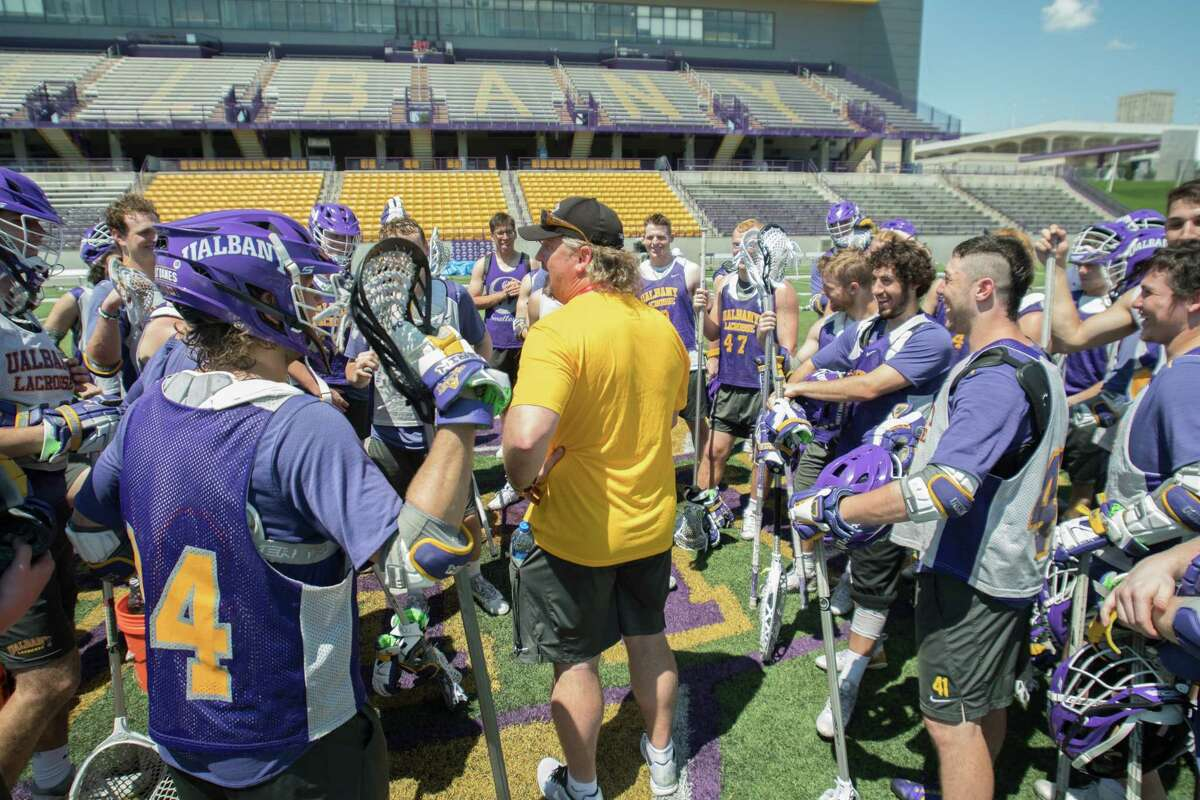 UAlbany players surround head coach Scott Marr following their practice on Wednesday, May 9, 2018, in Albany, N.Y. (Jenn March, Special to the Times Union)