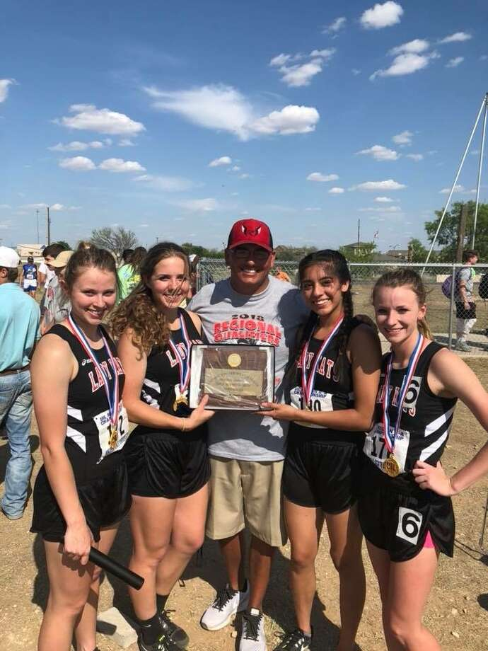 Garden City's 1,600 relay team of (left to right) Allison Halfmann,  Lyndee Walker, Coach Ollie Wilburn, Ixchel Sotelo and Kenzie Schaefer  pose after winning at the Region II-A meet in San Angelo on April 28. Photo: Courtesy Photo