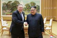 "In this Wednesday, May 9, 2018, photo provided on Thursday, May 10, 2018, by the North Korean government, U.S. Secretary of State Mike Pompeo, left, shakes hands with North Korean leader Kim Jong Un during a meeting at Workers' Party of Korea headquarters in Pyongyang, North Korea. Independent journalists were not given access to cover the event depicted in this image distributed by the North Korean government. The content of this image is as provided and cannot be independently verified. Korean language watermark on image as provided by source reads: ""KCNA"" which is the abbreviation for Korean Central News Agency. (Korean Central News Agency/Korea News Service via AP)"