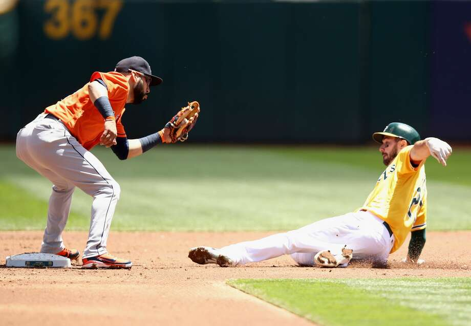 OAKLAND, CA - MAY 09:  Marwin Gonzalez #9 of the Houston Astros tags out Matt Joyce #23 of the Oakland Athletics on a steal attempt in the first inning at Oakland Alameda Coliseum on May 9, 2018 in Oakland, California.  (Photo by Ezra Shaw/Getty Images) Photo: Ezra Shaw/Getty Images