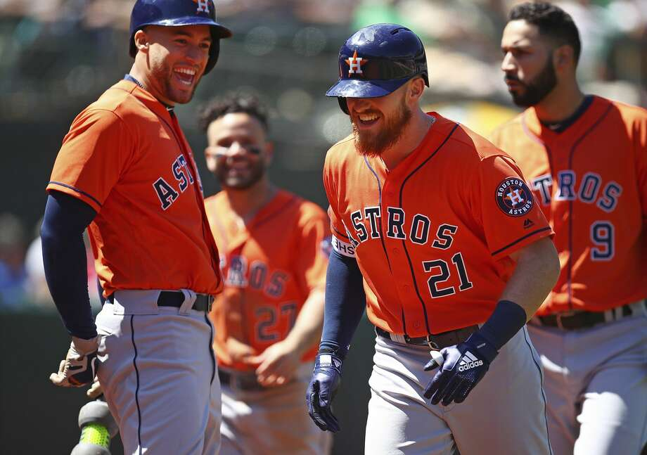 Houston Astros' Derek Fisher (21) celebrates with George Springer, left, after hitting a home run off Oakland Athletics' Daniel Mengden in the seventh inning of a baseball game Wednesday, May 9, 2018, in Oakland, Calif. (AP Photo/Ben Margot) Photo: Ben Margot/Associated Press