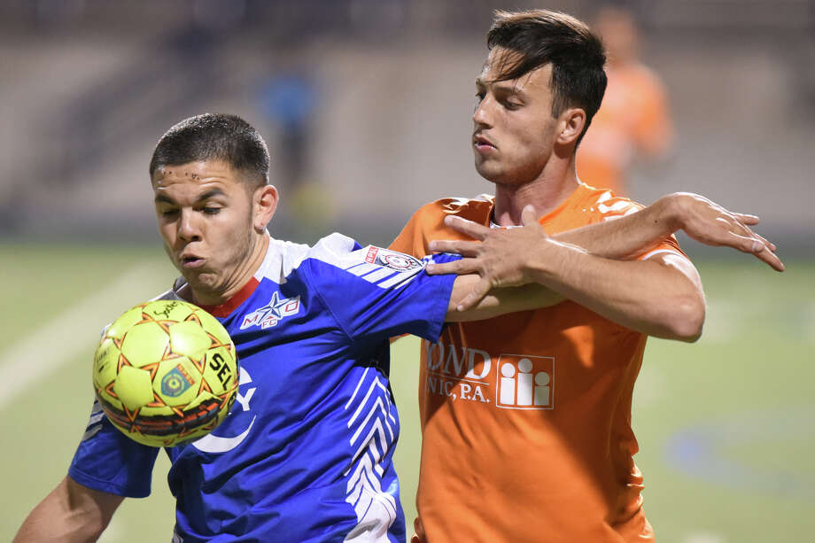 Midland-Odessa's Maxi Galizzi (left) goes after the ball against Lakeland Tropics' Caue Salgado (right) May 9, 2018, at Grande Communications Stadium. James Durbin/Reporter-Telegram Photo: James Durbin