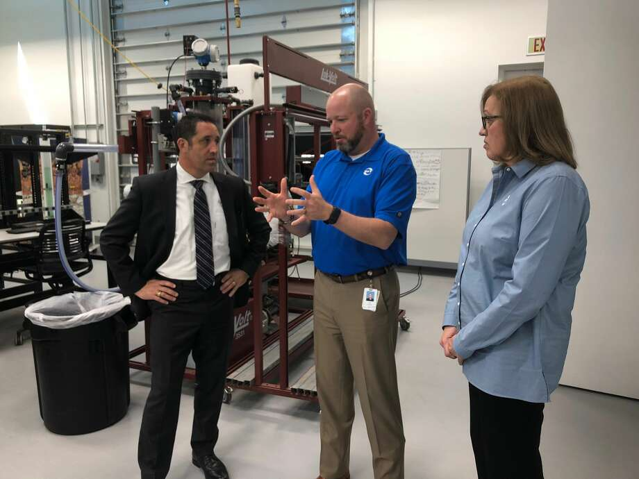 Comptroller Hegar, left, listens to Matt Henwood, technical training manager, and Barbara Bergersen, senior vice president Permian EOR for Occidental Petroleum during a tour of the company's Permian Enhanced Oil Recovery business unit. Photo: Photos Courtesy Comptroller's Office