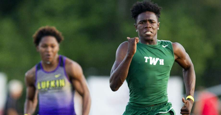 The Woodlands' KeSean Carter took first in the boys 100-meter dash during the District 12-6A high school track meet at College Park High School, Thursday, April 12, 2018, in The Woodlands. Photo: Jason Fochtman/Houston Chronicle
