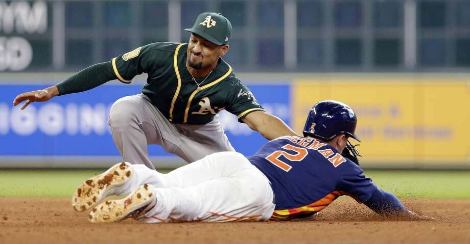 Houston Astros' third baseman Alex Bregman (2) steal second base and advanced to third on the throwing error to Oakland Athletics' shortstop Marcus Semien (10) during the seventh inning of a baseball game Sunday, April 29, 2018, in Houston. (AP Photo/Michael Wyke) Photo: Michael Wyke/Associated Press