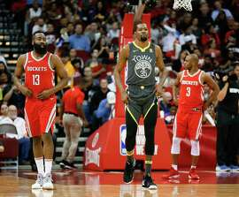 HOUSTON, TX - JANUARY 20:   James Harden #13 of the Houston Rockets, Kevin Durant #35 of the Golden State Warriors and Chris Paul #3 of the Houston Rockets at Toyota Center on January 20, 2018 in Houston, Texas. NOTE TO USER: User expressly acknowledges and agrees that, by downloading and or using this photograph, User is consenting to the terms and conditions of the Getty Images License Agreement.  (Photo by Bob Levey/Getty Images)